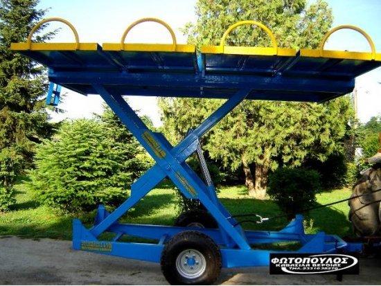 Υδραυλική σκάλα. Ανυψωτική πλατφόρμα μεταφοράς.